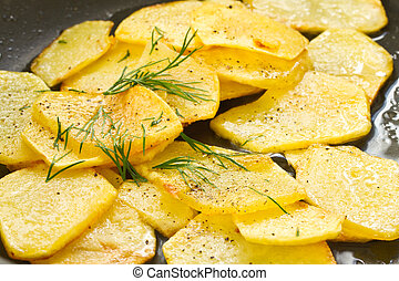 fried potatoes - hot roast potatoes with dill and black...