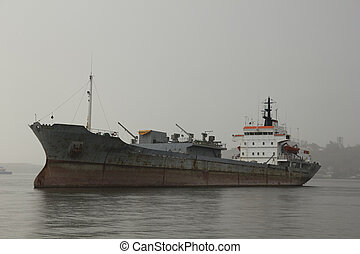 Merchant ship - Boat deteriorated moored in the bay of...