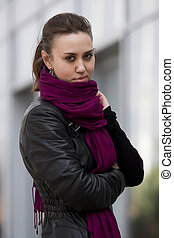Woman in black leather jacket and purple scarf