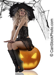 sexy witch sitting on a pumpkin - very sexy and attractive...