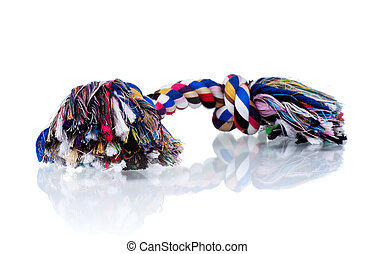 Dog toy - colorful cotton dog toy on a white background