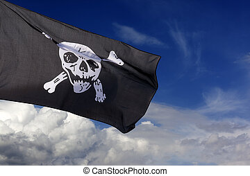 Jolly Roger pirate flag against blue sky with clouds