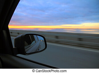 view in the rearview mirror on the car on highway