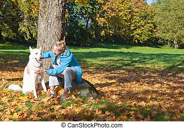 The woman with a dog in autumn park