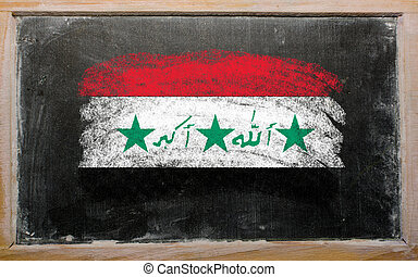 flag of Iraq on blackboard painted with chalk