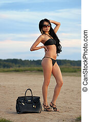 Asian woman on vacations at the sandy beach