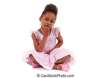 Cute little African Asian girl sitting on the floor,...