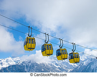 Cablecar - Row of cablecars moving skiers to the slope...