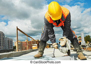builder working with cutting grinder - Builder worker with...
