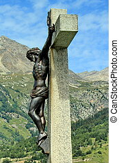 Jesus cross next to the mountain - Side of a metallic...