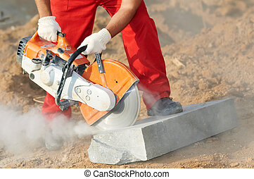builder at cutting curb work - construction worker at curb...
