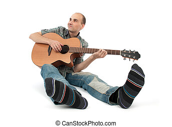 Classical guitarist with acoustic six string guitar isolated...