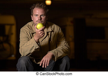 ware house worker - man eating apple