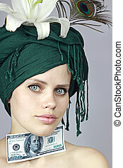 girl with a monetary denomination - young girl holds a...