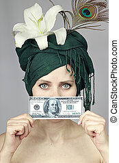 girl with money near the person - young girl holds a...