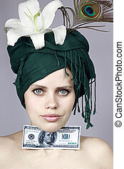 girl with money - young girl holds a monetary denomination...