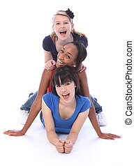 Happy multi ethnic girl friends human totem pole - Human...