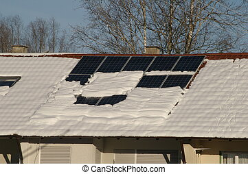 solarcell - solar cells on a snowy roof in winter