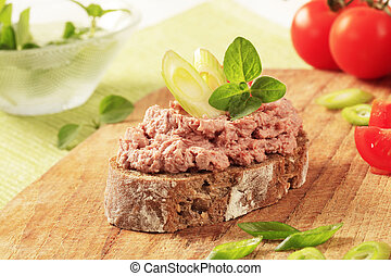 Bread and pate - Slice of brown bread and meat spread