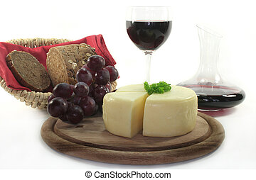 Cheese - a cheese with fresh dark grapes