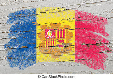 flag of andora on grunge wooden texture painted with chalk -...