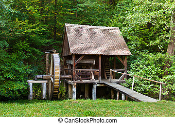 Watermill replica - Ancient wooden watermill replica in a...