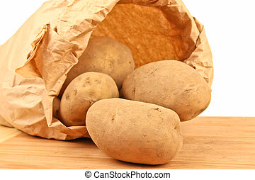 Fresh potatoes in a brown paper bag