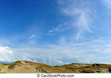 clouds on sky - White clouds on blue sky over dunes