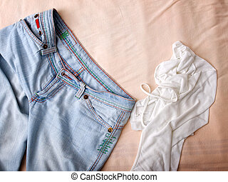 Clothes mess - Crumpled pants and shirt were thrown on the...