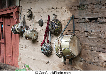 Old traditional indian drums on wooden wet wall, focus on...