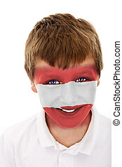 Young boy with austria flag painted on his face