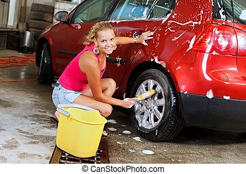 Sexy woman carwash - Sexy young woman washing the wheels of...