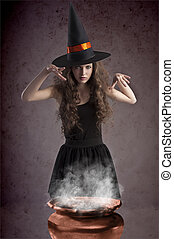pretty witch making some spells - young and pretty girl...