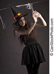cute witch looking scared - sweet and cute girl dressed as a...