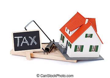 Tax as a mousetrap - Miniature house in mousetrap of taxes,...