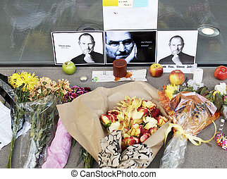 Tribute to Apples Steve Jobs - Flowers,candles and photos of...