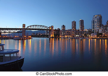 The Burrard bridge and False creek waterway at dusk, Canada...