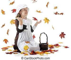 Thrilled with Falling Leaves - A young Pilgrim girl...
