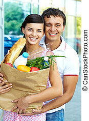 Shopping couple - Portrait of a happy couple with foodstuff...