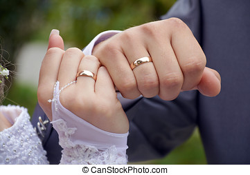 Wedding rings - The pair of a newly-married couple shows...