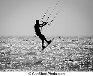 Kite Surfer Silhouette - A Silhouette of a kite surfer in a...