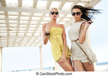 adorable women wearing sunglasses