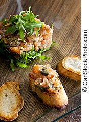 salmon tartar with ruccola
