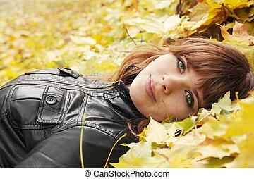 girl on maple leaves