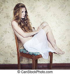 Retro photo of a beautiful young woman with red curly hair