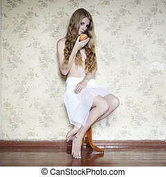 Retro photo of a beautiful young woman with peach