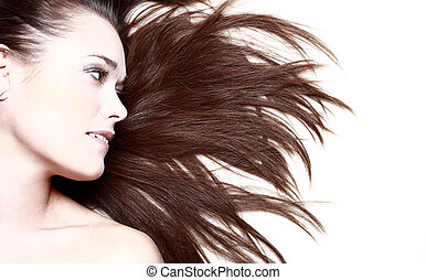 woman with her hair blowing and smiling