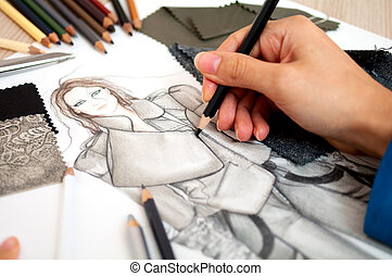 fashion designer - Fashion designer is drawing an artistic...