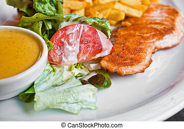 grilled salmon and lemon - french cuisine dish with tomato...