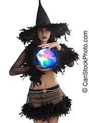 the young witch posing with magic ball - close up portrait...